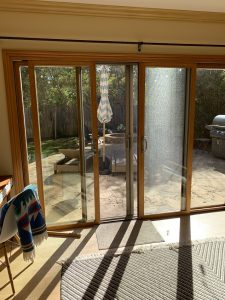 Installation Driftwood Beige Retractables Screen Doors in Malibu